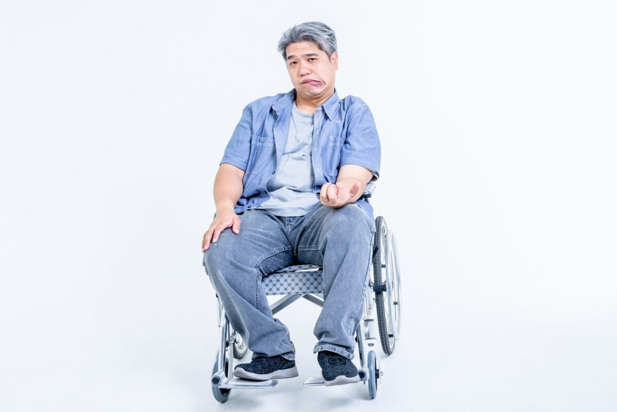 asian-middle-aged-man-sitting-wheelchair-his-hands-are-kinking-due-nervous