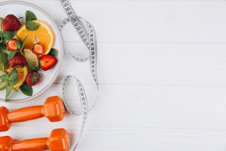 Diet plan, menu or program, tape measure, water, dumbbells and d
